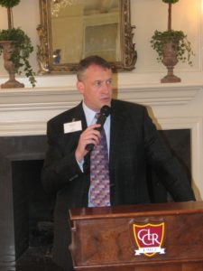 """Dr. Michael Mancino speaks at a """"Beautiful Minds"""" luncheon."""